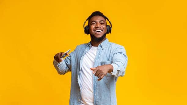 black man dancing with headphone